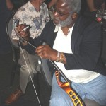 """The Tyler Rose""  and NFL Hall of Famer Earl Campbell signs  Frank's bow after the show.  Notice the bow is the burnt orange color similar to the University of Texas."