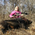 Author's 15 year old daughter, Alexis with a huge Texas feral hog which was dropped with a single shot