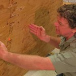 Wade Nolan examines the shot window on angled plywood. The angle makes it challenging to aim as the angle accents the aim point.