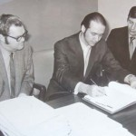 Don, M.R. and Bob signing the papers to create Bowhunter Magazine.