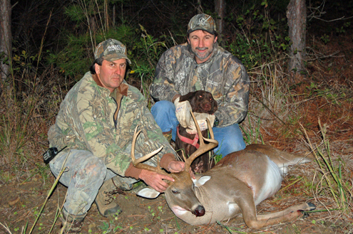Larry Norton (r) with Henri Billiot and Katie and a fine whitetail buck.
