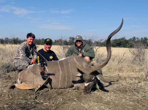 Using his recurve bow Ty's Dad Al happily poses with his majestic Kudu trophy.