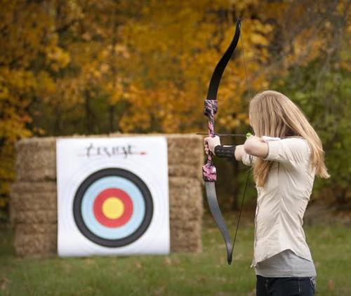 Tribe-Archery-girl-shooting