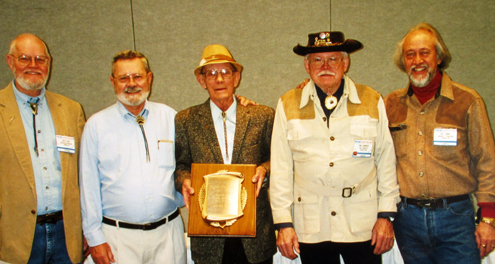 """HALL OF FAMERS -- That's """"Mr. Compound Bow"""" Tom Jennings standing next to me (right) at his 1999 induction into the Archery Hall of Fame. My good pal and BOWHUNTER business partner Don Clark, who was serving as the AHOF Executive Director, is seen at left beside another Class of '99  AHOF inductee, Dick Lattimer. In the center is Floyd Eccleston, holding his own AHOF plaque. The ceremony took place in Indianapolis at the annual Archery Trade Association Show.  Of these four friends, I'm the only one still living."""