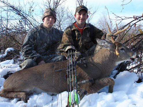 """The Author and hunting buddy Jamey Mann with Paul's fine trophy whitetail. """"Hunting buddies only make a successful hunt better. When a buddy is excited as you are about your successful hunt, there's not a stronger feeling of camaraderie."""""""