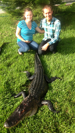 Gator hunting is a family friendly activity. This is my son and daughter-in-law (7 months pregnant) with a big gator she harvested.