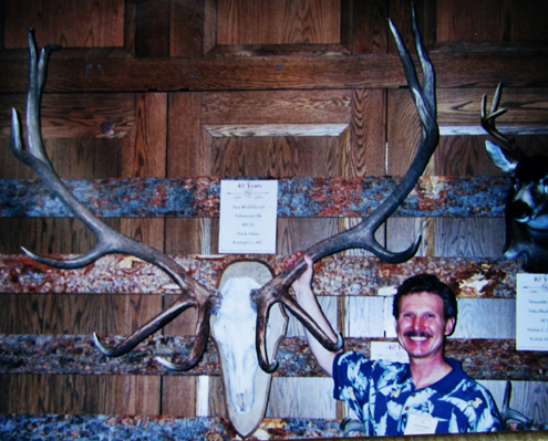 CHUCK ADAMS & ELK RACK I SHOT THIS PHOTO OF CHUCK ADAMS and the antlers of his World Record elk at the Pope and Young Club awards banquet in Salt Lake City. Chuck made history in 1990 by becoming the first bowhunter to collect all recognized species of North American big game.