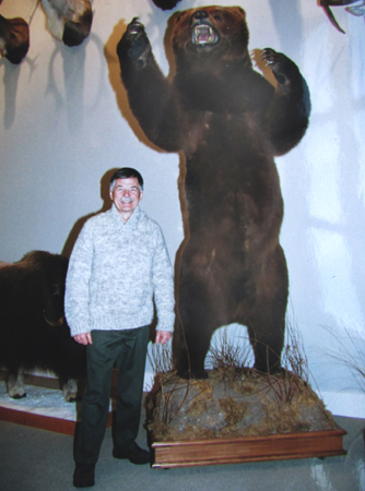 "MICHIGAN BOWHUNTER GARY BOGNER became the fifth man in archery history to collect a bowhunting ""Super Slam."" I took this photo of Gary in his Michigan trophy room during a deer hunt we shared. Active in Safari Club International, he's traveled the world and amassed an amazing collection of big game animals. To date, only a handful of bowhunters have"