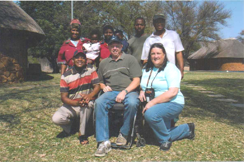 Author and wife Diane with the camp staff .