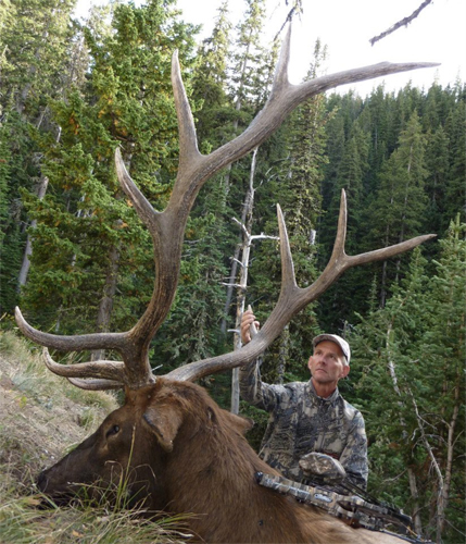 Author with one of many archery trophies.