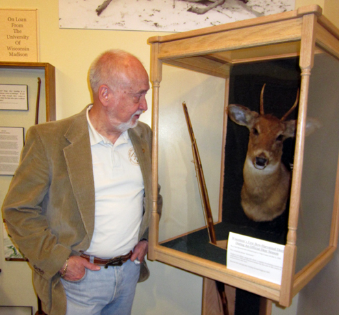 "This Roy Case display in the Pope and Young Club Museum contains the deer mount and longbow from an historical 1930 Wisconsin bowhunt. Case was the first licensed bowhunter to legally take a whitetail deer in the United States. He's also widely credited with coining the term ""bowhunter."""