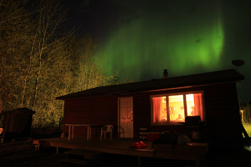 Northern lights cast their beautiful green hue across the midnight sky