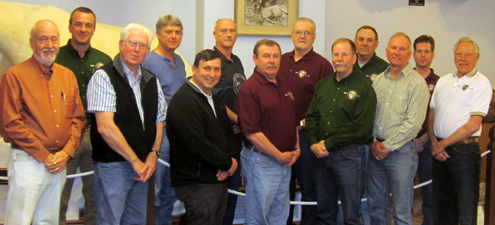 There'll be numerous new faces replacing multiple members of the outgoing Board (shown here). From left are M. R. James, Immediate Past President, who will be replaced by Roger Atwood, a loser in his quest for a third presidential term; Jeff Pals, Membership Chairman; Glenn Hisey, First Vice President, who lost his bid for a Director's seat; Dirk Dietrich, Director; Jay St. Charles, Director; Doug Clayton, Director, who won re-election; Craig Oberle, Treasurer; Roger Atwood, President, who was defeated by challenger Jim Willems; Tom Nelson, a Director who won his bid for 1st Vice President; Mike Kistler, Records Chairman; John Gardner, 2nd Vice President, who won re-election for his second term; Kevin Hisey, Executive Secretary; and Mike Schlegel, Conservation Chairman. Directors St. Charles and Dietrich have two years remaining on their current terms. Board members Pals, Oberle, Kistler, Schlegel, and Kevin Hisey are all appointed members and will be re-appointed or replaced by incoming President Jim Willems.