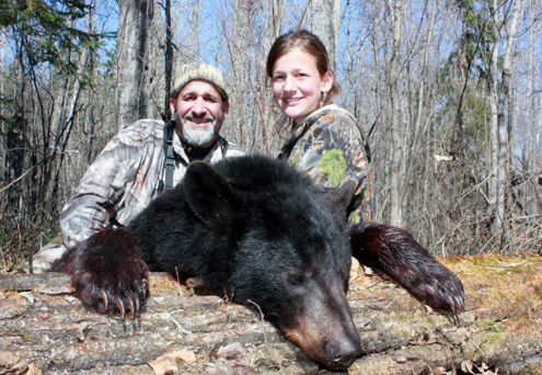 Author and daughter Baylee celebrate her first bear.