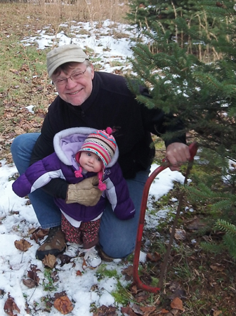 Bella and gramps cutting her first Christmas tree.