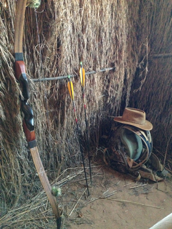 In the blinds. My 55-pound recurve, the arrows tipped with Zwikeys and my hunting bag and hat.