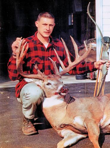Mel Johnson with record breaking buck.