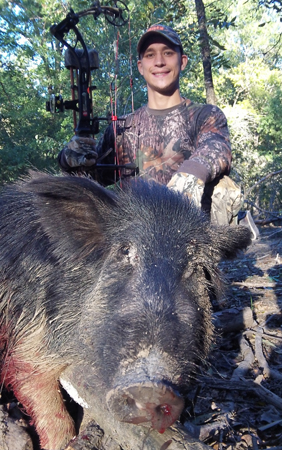 Cory shot this porker from an elevated platform near a feeder. It traveled toward water but ran out of juice in 50 yards. It was an easy trail to follow.