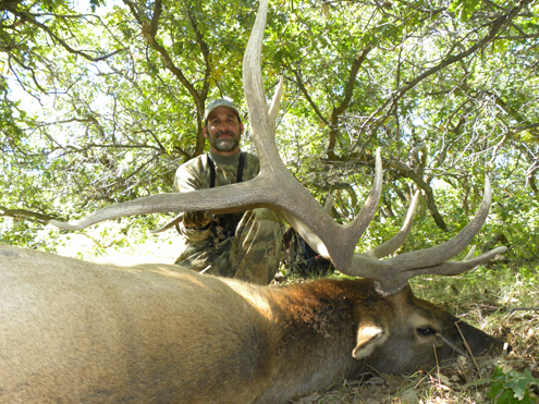 Author with his trophy bull elk.
