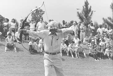 Fred giving an archery demonstration.