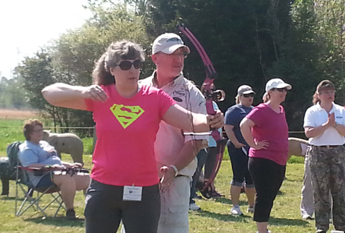 Jim and Lynne instructing the ladies on stance and release