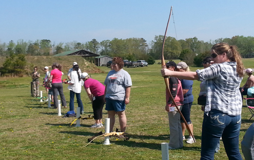 The ladies in the intro to archery class shooting. Photo:  B.B. Gillen Photo:  B.B. Gillen