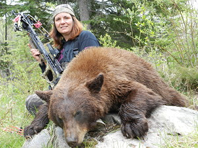 The first of 3 near 7' black bears taken from the same site, using Bear Trap!