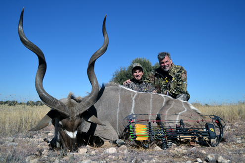 """What a giant Kudu bull! Wyatt made short work of this massive Kudu bull as well. We couldn't tel who's smile was bigger- Wyatt's or Scott's"""