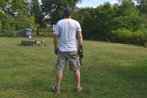 Here the shooter is standing perpendicular to the target, feet shoulder width apart, with a straight spine.