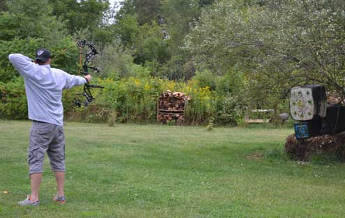 When first learning proper shooting technique, don't wander too far away from the target. Ten feet is a perfect beginning distance to practice form.