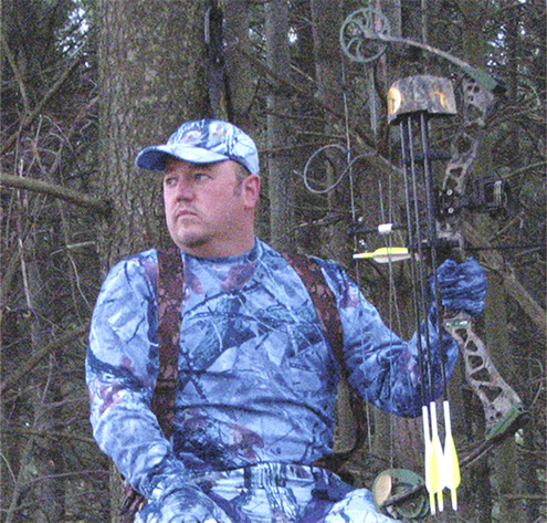 This is how deer see this same hunter wearing clothing washed in laundry detergent with brighteners.