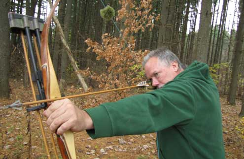 Carey's longbow is hand crafted by him. Carey is an ace carpenter in real life.