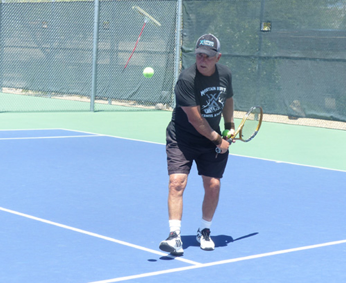 Tennis is a great aerobic sport that builds stamina and good hand – eye coordination. Here I'm doing a pre-match warm-up.