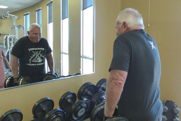 Shrugs build the traps and is a good finishing exercise.