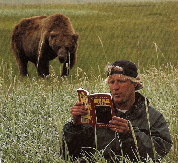 Here Treadwell reads Larry Kanuits bear attack book in a photo that was later photo shopped for a promotional photo.