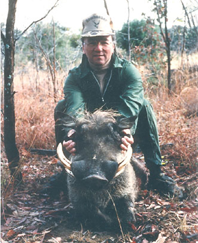 A great shot, a 100 yard track and the author poses with his first Wart Hog.