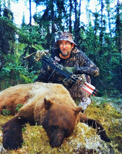 Every bowhunter understands the fact arrows kill by creating massive blood loss. But there's absolutely no need to show photos of blood-soaked animals. I snapped this photo of Dwight Schuh posing with a beautiful Saskatchewan color phase black bear he arrowed on a hunt we shared. People who disrespect their kills couldn't have had much respect for the animal when they were alive.