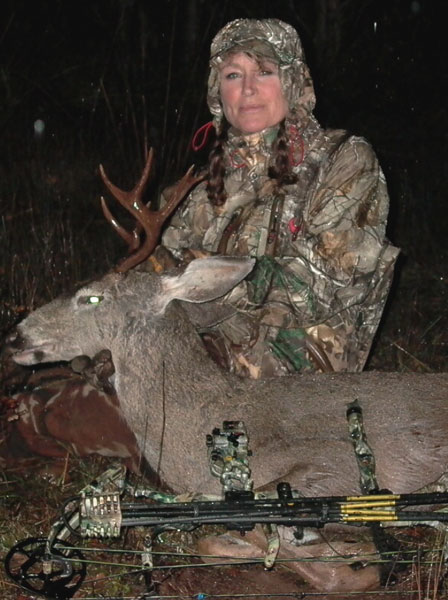 Lisa with her textbook shot 2014 buck.