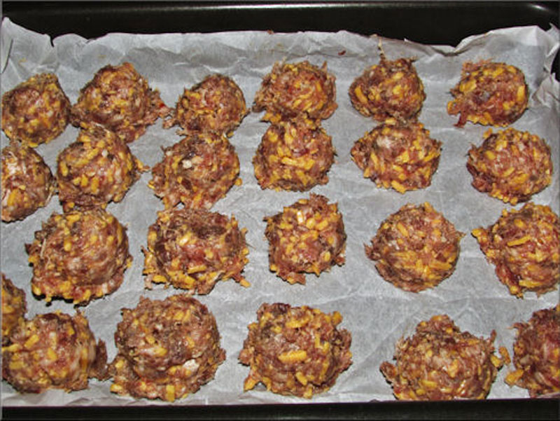 My pan full and going into the oven with non-stick parchment paper. I should have put down non-stick parchment paper under the Venison Sausage Meatballs so they wouldn't stick. My cookie sheet was a mess!!! I learned my lesson on this one. I had to soak my cookie sheet on top of scrubbing it to death.