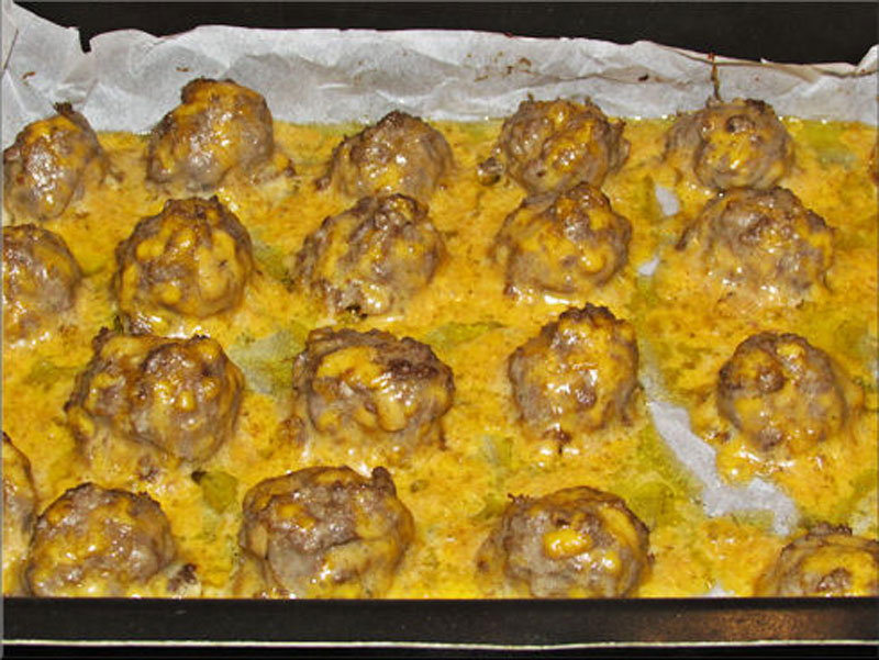 Turn out so much better... cooked 15 minutes instead of 20 minutes and the parchment paper was a lifesaver as far as cleaning the pan. I am going to cut back on the cheese since it seems so much of it melted out anyway. Note: You will notice the balls won't increase in size like normal sausage balls because it does not have any biscuit mix, flour of any kind. Just meat, egg and cheese.