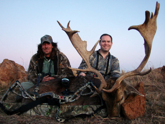 Abrie with Jason Stone client, renowned bow hunter Ricardo Longorio, whom Abrie guided onto this world record stag