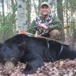 The author with an Alberta black bear killed on May 24th with a hybrid longbow.