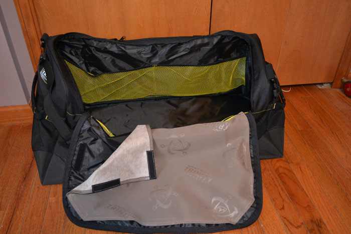 The inside of the Trinity Duffle Bag. We can see some of the pockets and a removable Trinity scent adsorbing panel.