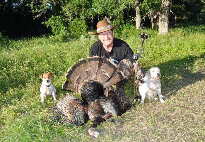Author with his turkey and the Jack Russell Terriers who helped find it.