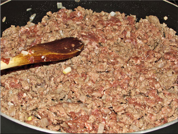 After sautéing chopped onions I added ground venison to brown. A good time to add your bouillon cubes.