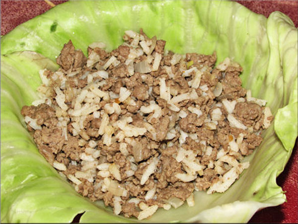 In the center of the cabbage leaf add equal amounts of venison/rice mixture. Note: The recipe called for the cabbage leaves to cook for one minute which left parts of them a bit crunchy. When I cook them again I am going to try two minutes to see how they turn out.