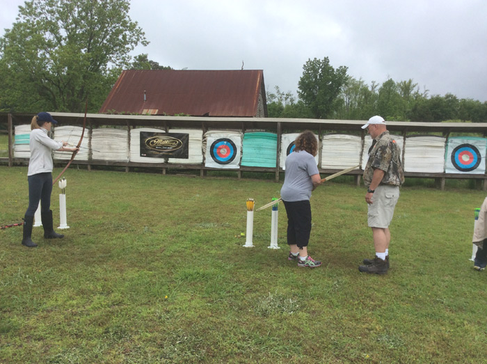 Jim Fradyhelping the ladies with the recurve and longbow