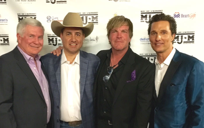 Author with Coach Mack Brown, singer Jack Ingram and actor Mathew McConaughey .