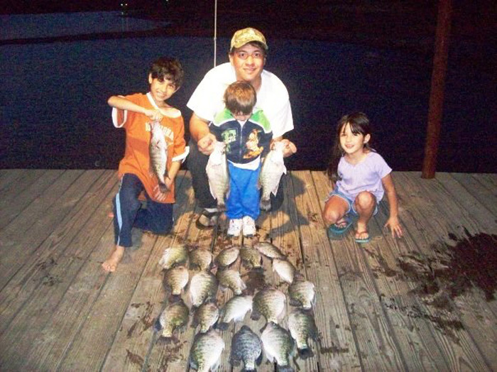 Rudy Garcia with his children enjoying the fishing.
