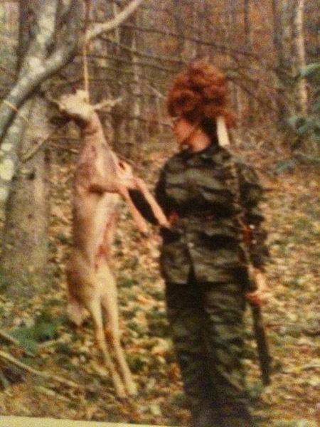 Cathy Addington 1971 with a deer and a whole lot of hair.